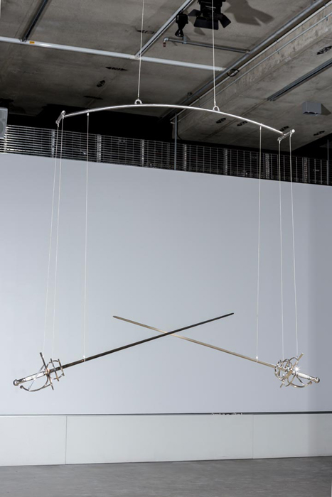 Roy Ananda,  Untitled.  2015. Swords, steel,   motor, microcontroller, fixings. Dimensions variable. Photograph by Sam Roberts