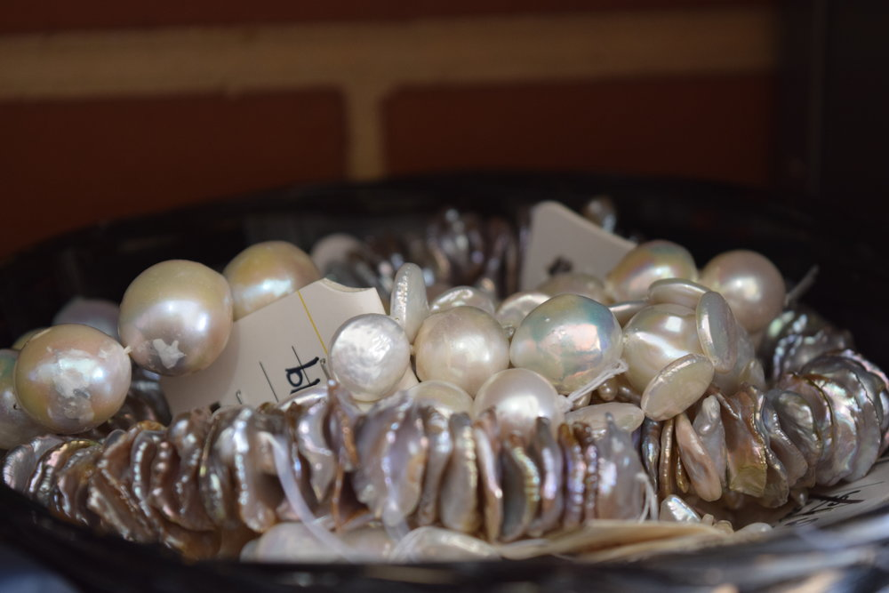 Some of the pearls found in Olivia Dryden's studio to be used in her jewellery, wall works and experimentations.