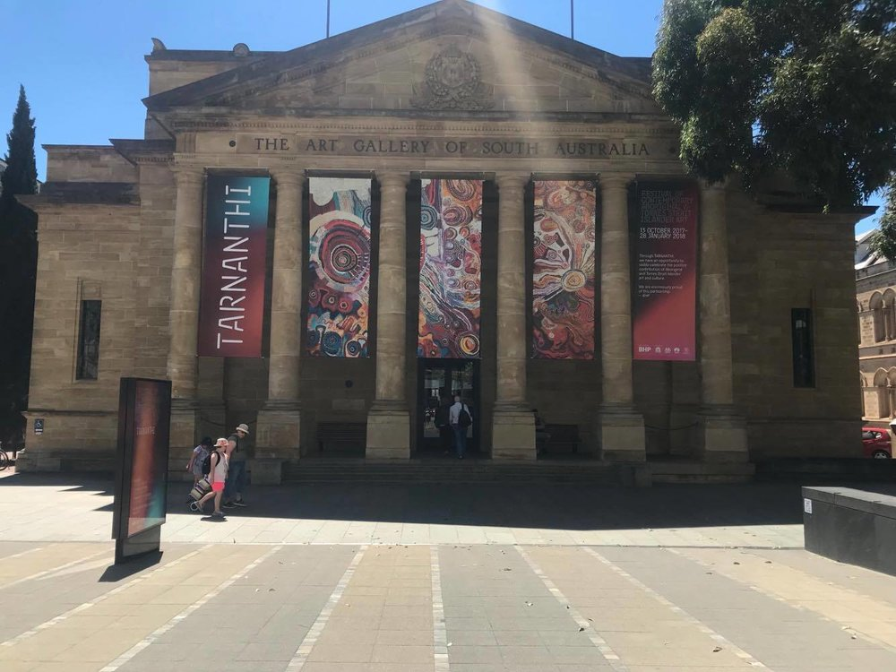 The entrance of the Art Gallery of South Australia with it's TARNANTHI Festival banners.
