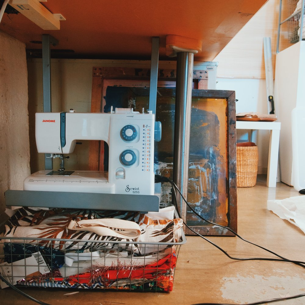 Under Bella's desk lives her frequently used sewing machine and silk screens.