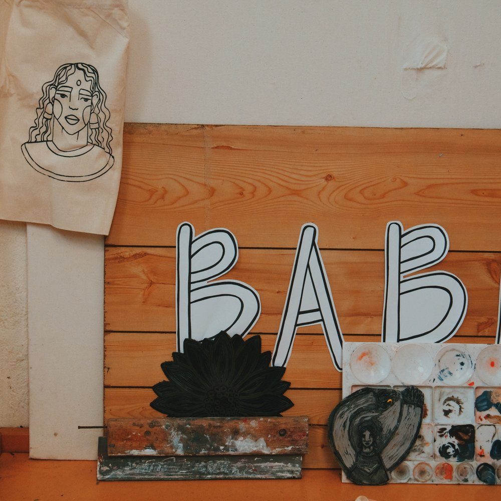 Babe sign used at markets with bits and pieces in workshop.