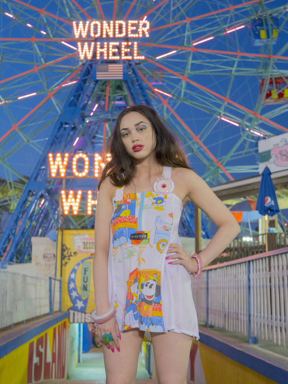 Take Me To Coney Island - Yolo For Life Apparel meet's one of New York City's most iconic places! Flashing lights, summer nights, check out this sweet-dream-or-a-beautiful-nightmare editorial!Check it out!
