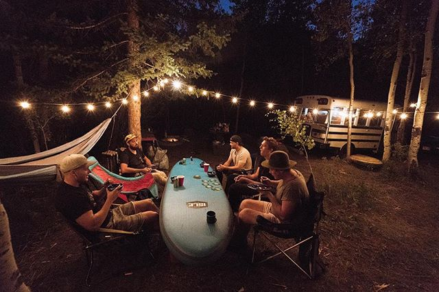 Sometimes you have to improvise. We learned that paddle boards make great tables for card games while you're camping. Who wants to go camping this weekend?