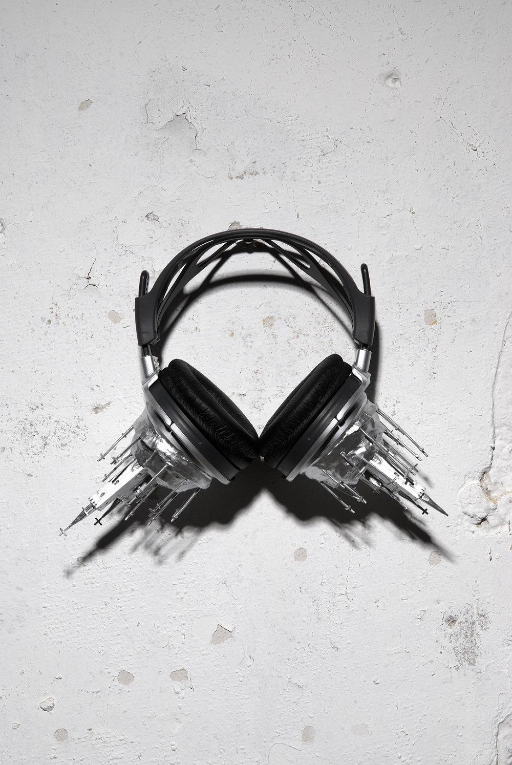 "St. Peter, Christ's Rock, 2007.  Ceramic, headphones, paint, 9 x 13"""