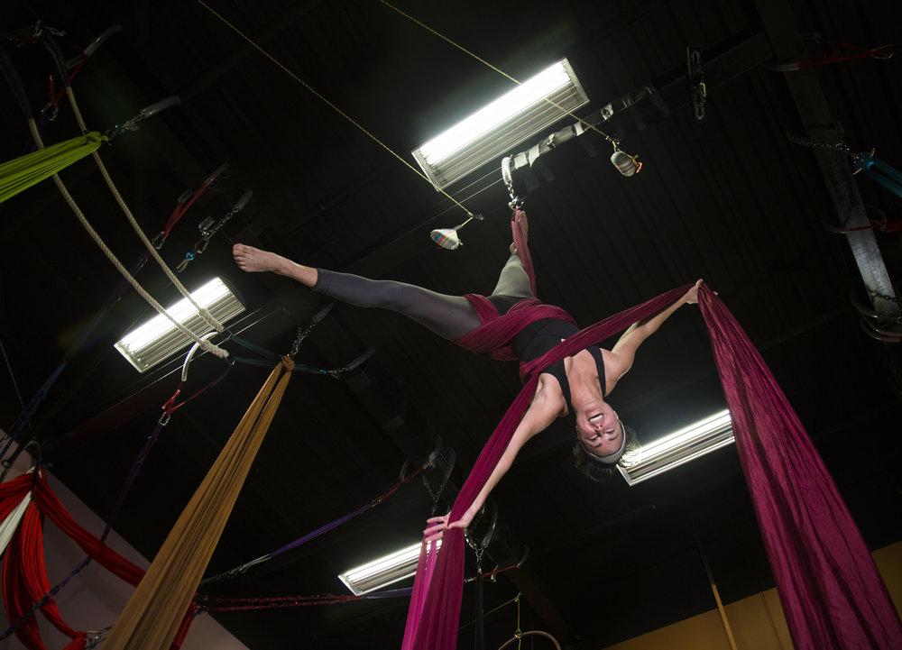Morgan Siem, an aerialist, practices her routine in a studio in Raleigh, N.C., on Oct. 19, 2016. Hear her talk about aerial silks below: