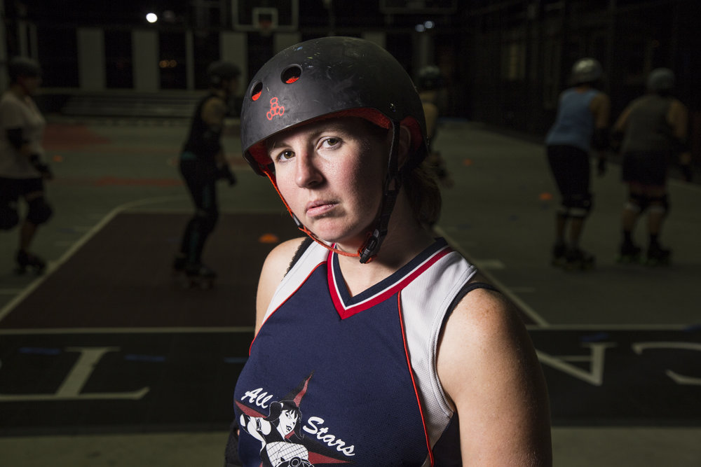 "Lora Johnson, whose roller derby name is ""Jammawockie,"" stands for a portrait during her team's practice in Durham on Oct. 18, 2016. Hear her talk about skating below:"