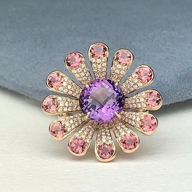 LIVE AUCTION!!! LIVE AUCTION!!! Tag your friends! Starting bid $1055. GO!!! This unique cocktail ring is so beautiful and eye catching. It's set in solid 18k Rose Gold with beautiful high quality white diamonds. The center is amethyst and the edges are tourmaline.  Please comment below with your Bid