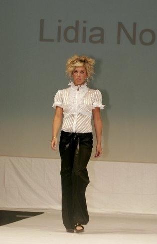 White semi-sheer, short sleeve blouse and black straight leg slacks with ribbon waist tie.
