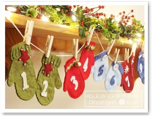 """Inspiration photo. The customer requested a """"hanging mittens"""" style of advent calendar as shown in this photo but in custom colours of cream, white, silver, and gold."""