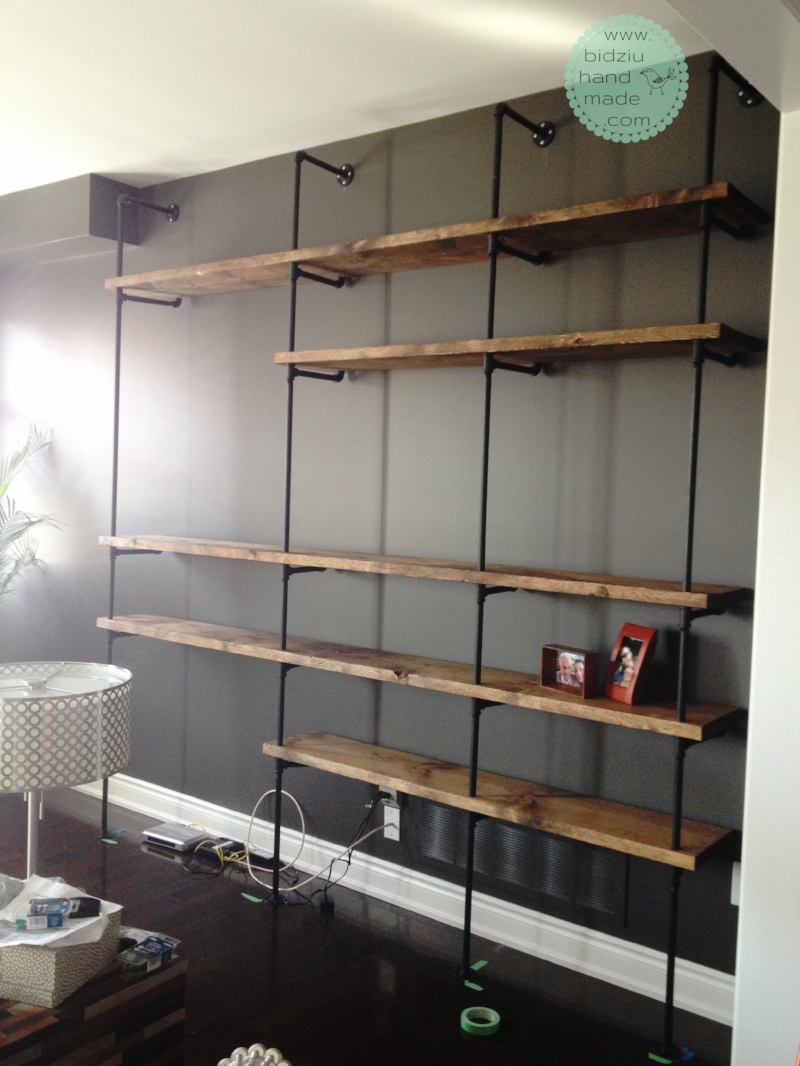 Final result! Industrial pipe shelving unit fully assembled. Last remaining step is to paint the screws on the flanges black to match the piping.