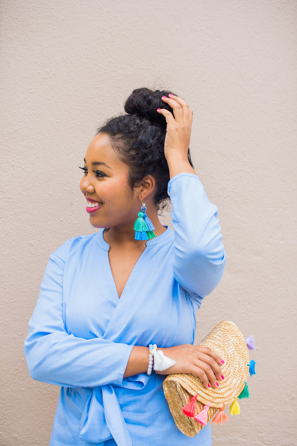 Aneris Photography   Sporting our new Rainbow Row clutch in pastels with our Greenhill tassel earrings.