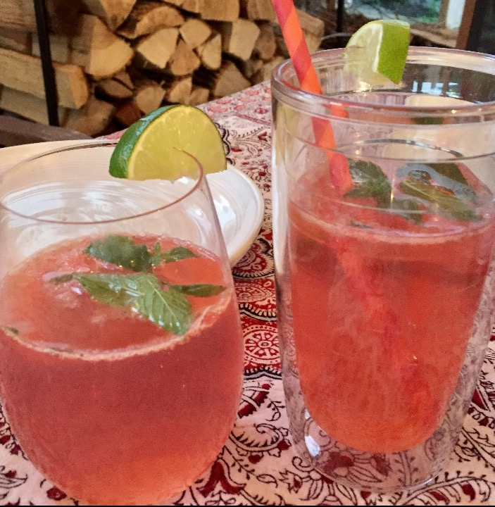 RASPBERRY- MEETS- MINT LEMONADE - LEVEL- EASY-1/3 fresh raspberries in a puree-1/3 lemon & lime Juice -1/3 seltzer water- A pinch of fresh Lone Oak Farm mint-A slice of lime (optional)