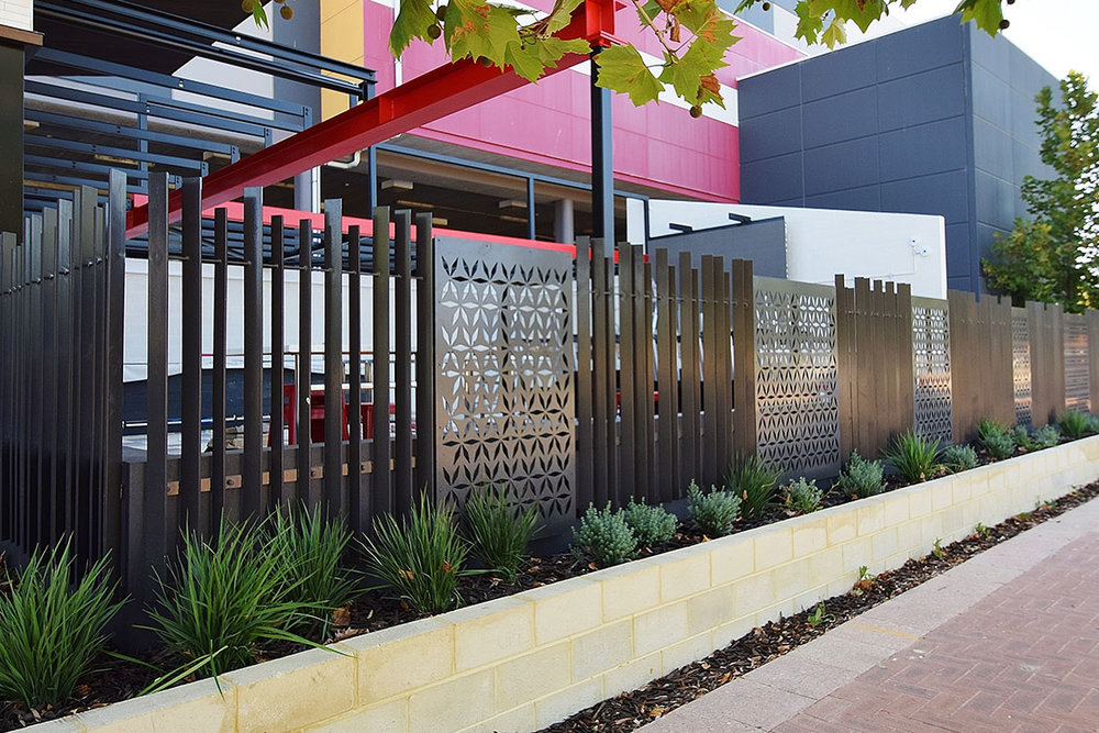 Shopping-centre-architectural-vertical-flatbar-fence-with-perforated-alum-2B.jpg