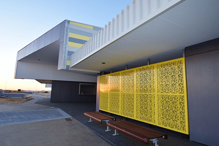 perforated-aluminium-screen-main-entry-and-timber-seats.jpg
