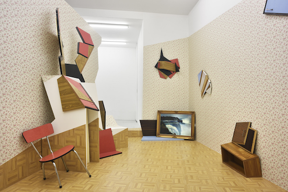 The detonate(d) room:  Formica furniture, linoleum,  wall paper , wood, chair, installation in situ.