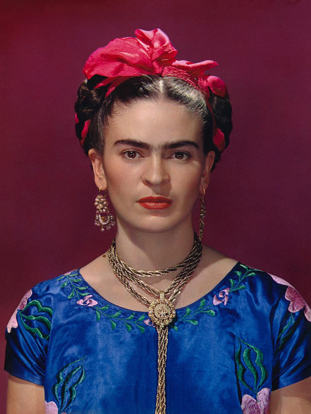 Frida Kahlo in blue satin blouse, 1939. Photograph Nickolas Muray © Nickolas Muray Photo Archives