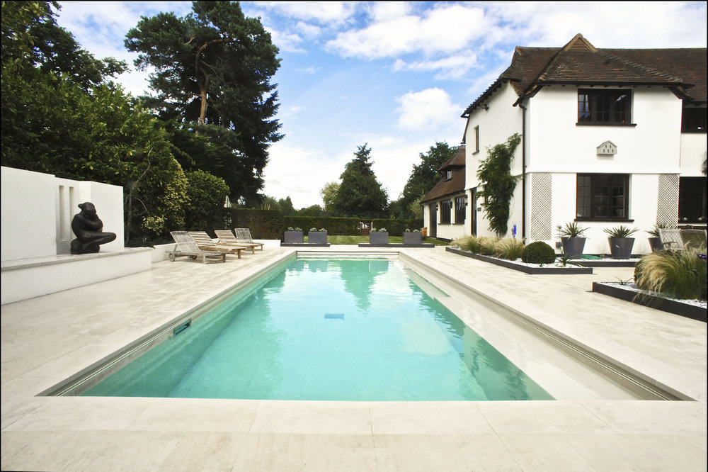 - Bespoke Italian porcelain tiles and creative sculptural planting elevate this pool to a glamorous elegant outside space.