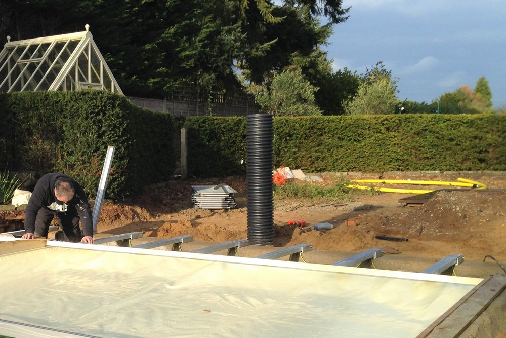 - Finally, to maintain heat and help keep this pool clean we installed an automatic pool cover.