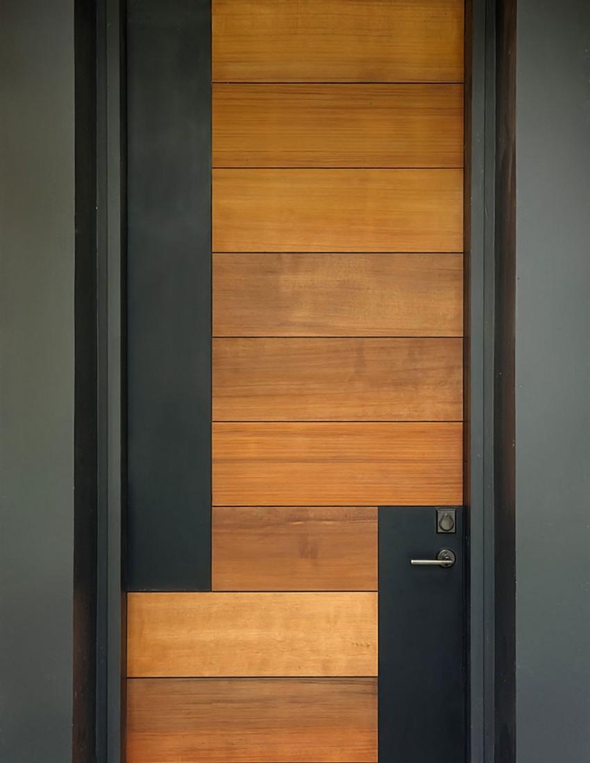 Контрастната - Дървени панели в топъл нюанс изскачат от неутралния външен интериор, докато вертикалнитематирани черни метални елементи осигуряватдопълнително декорация и контрапункт.