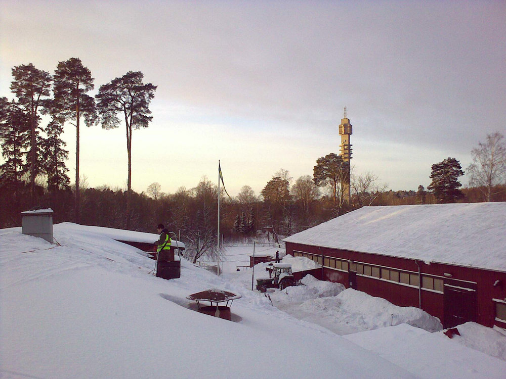 More shoveling, on horse stables in Gärdet (Cookie-Nose Tower in the background)