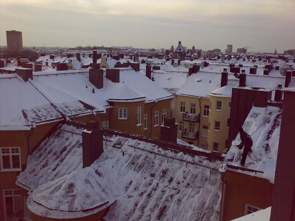 Shoveling the roofs of Kungsholmen, my Christmas break job