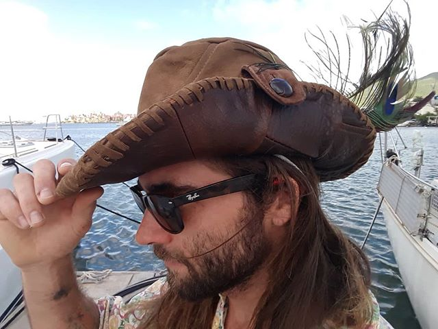 Just sold my first Pirate Captain's hat from the 'Into The Wilburness' adventure clothing range - apparel for the endless summer. Made with recycled leather jackets, peacock feathers and the caribbean trade winds.  #sail #sailinglife #adventure #endlesssummer #fashion #hat #pirate  #pirateslife