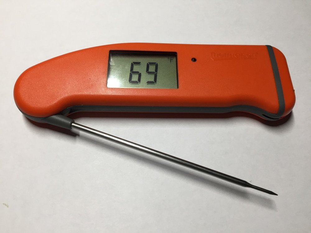 When open, the temperature display pops up.