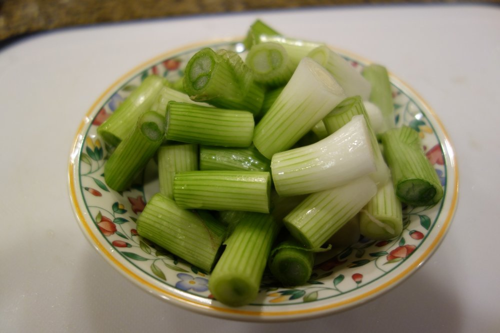 Only use the white and light green parts of the onions.
