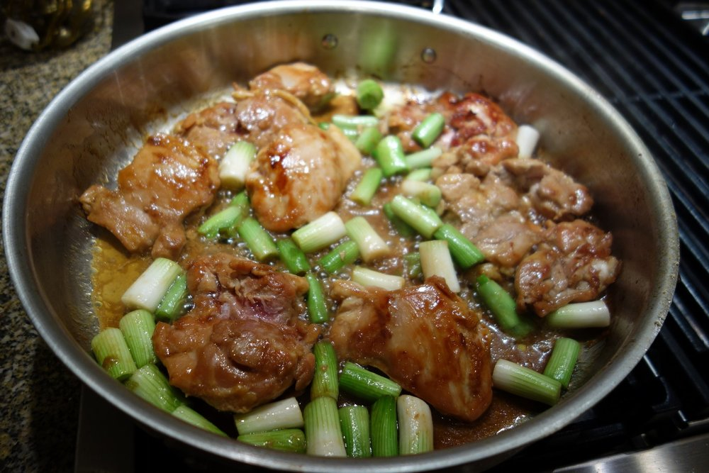 Add the green onions part-way through. cook about another 10 minutes until chicken reaches 175 internal temperature.