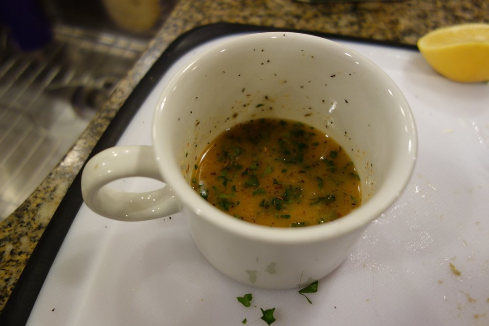 Finished butter sauce. The dark stuff is real parsley leaves - dried leaves can be substituted.