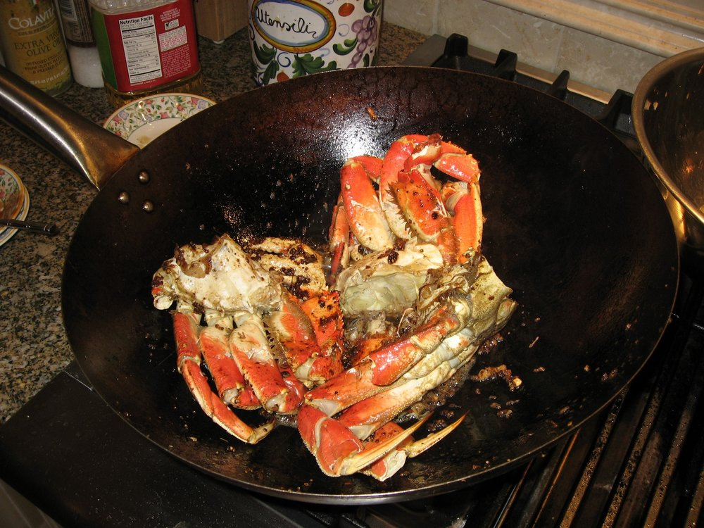 Add the crab to the black pepper sauce. Toss it constantly for several minutes to ensure it is covered in sauce and heated throughout.