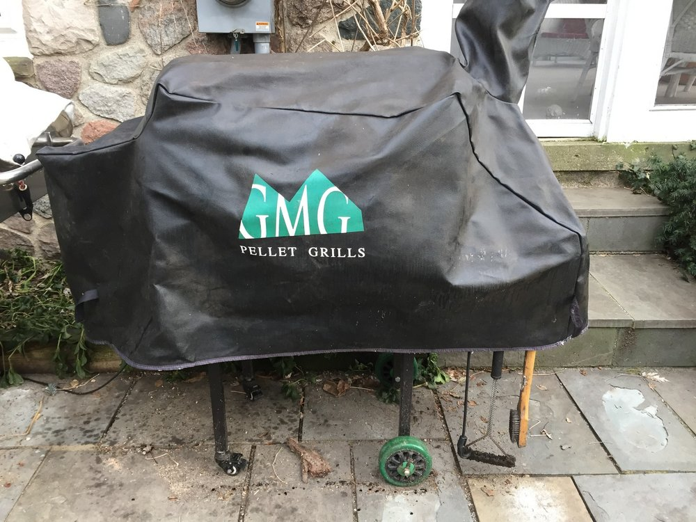 A rain cover is mandatory if you store it outside (as opposed to storing it in the garage and wheeling it outside to cook).