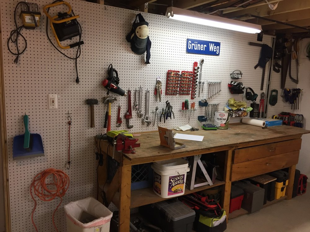 Pegboard wall. Buy the boards and hooks at Home Depot, Lowes, etc.
