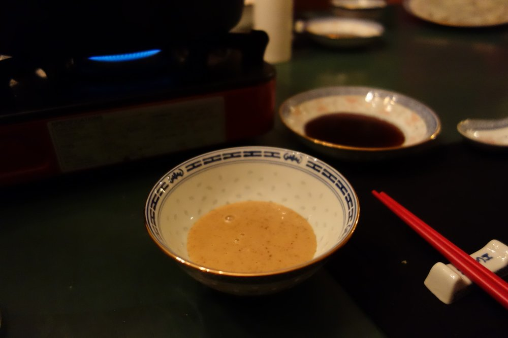 Each person should have a bowl with Sesame sauce (front) and a bowl with Ponzu sauce (rear) for dipping.
