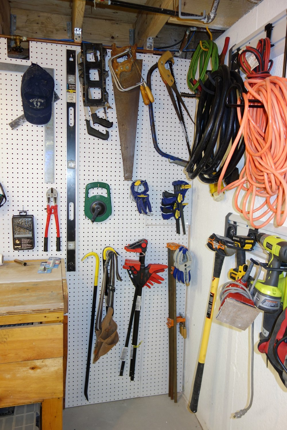 Having a full-length pegboard wall gives extra room for things like long furniture clamps, crowbars, and levels.