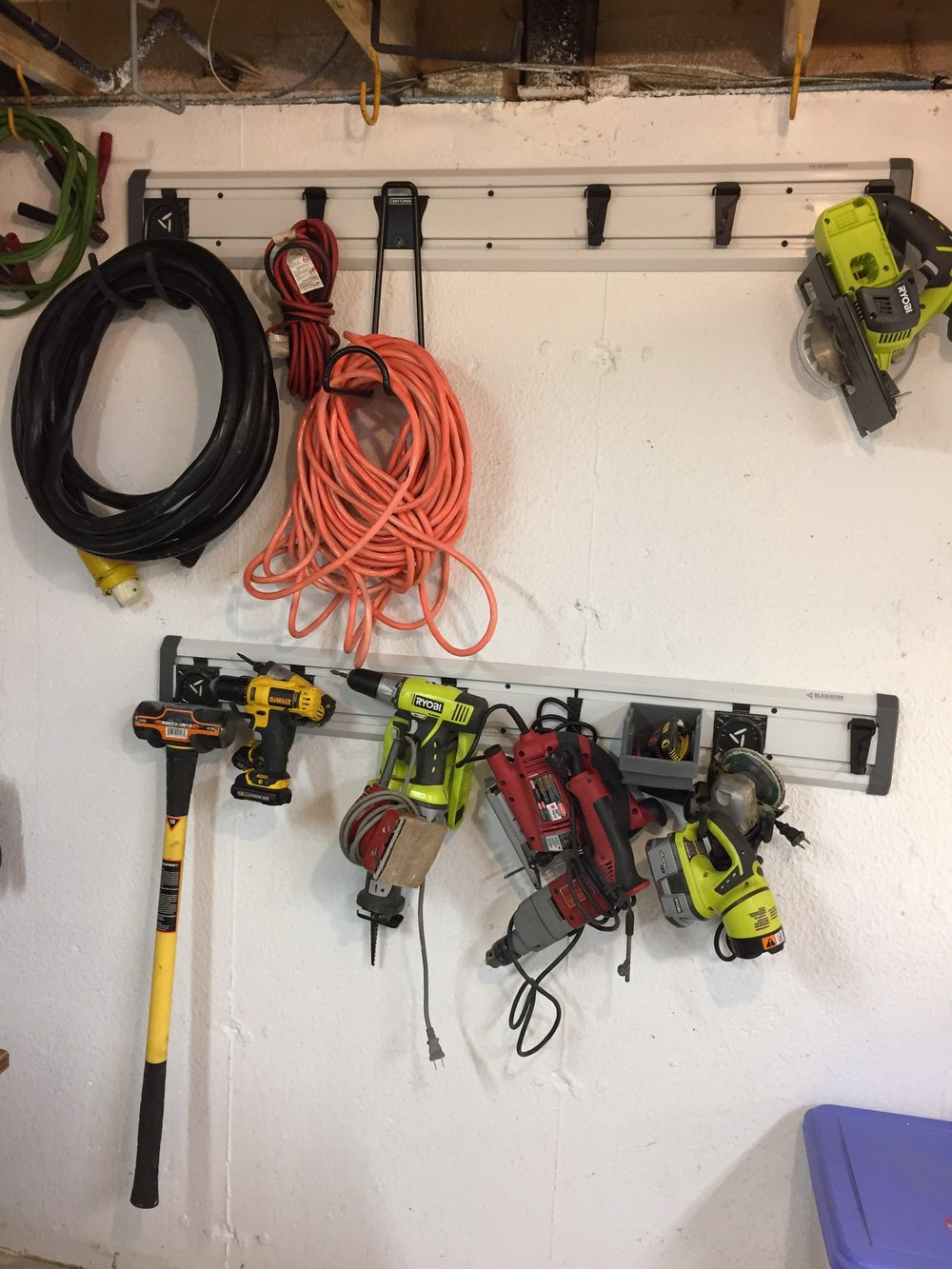 """My power tool wall. It's nice having my most frequently used tools out in the open where I can quickly find them, as opposed to looking through cupboards or drawers. A """"Big Hook"""" with 50 lb capacity easily handles the weight of a sledge hammer."""