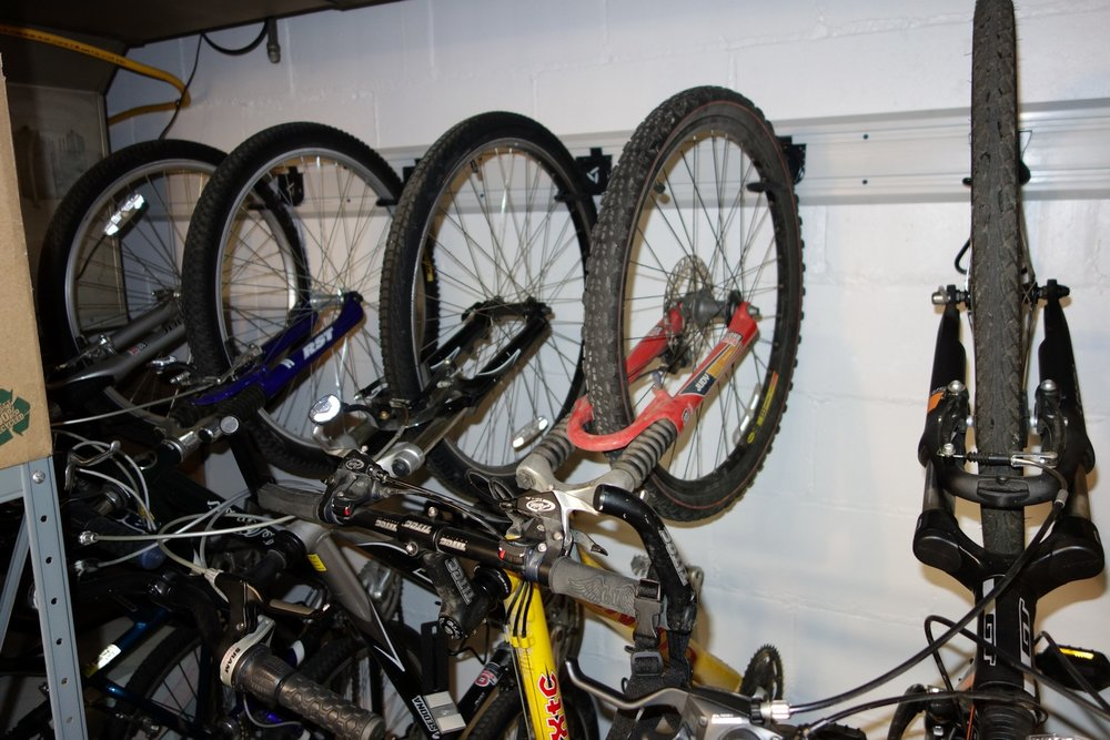 Bike Hooks work well to save space in the basement. I also used a Craftsman Hooktite vertical bike hook (right). They work about the same, so it's about which one costs less.