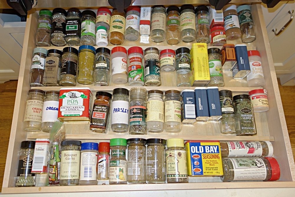Spices in the Top 3 rows are arranged alphabetically, so you can find them in a snap. Miscellaneous mixed spices fill the remaining space at the bottom. Simple wood strips were cut and simply put in place (not nailed or glued) as dividers.