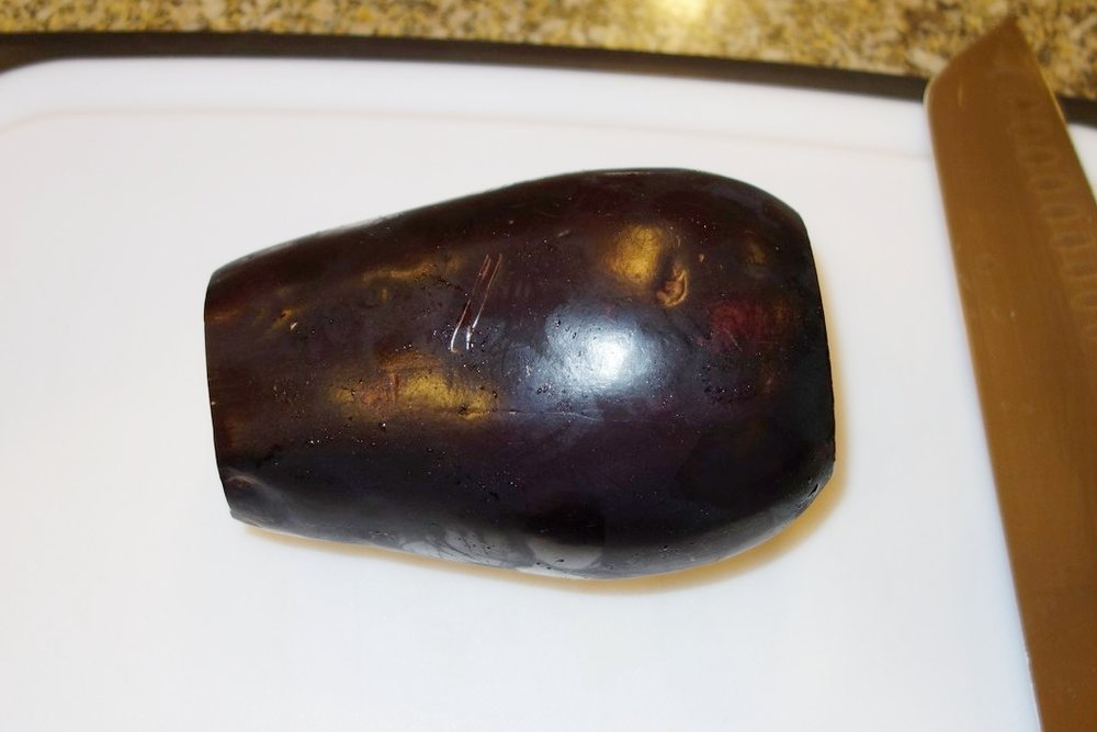 Start with a medium or large eggplant. Rinse it and cut both ends off.