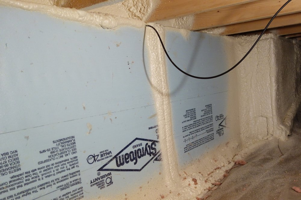 About a quarter of my crawl space had existing foam board insulation in place on the walls. For that area, I just had the insulation company seal the plastic flooring to the bottom of the foam, and insulate the rim joists above the wall.