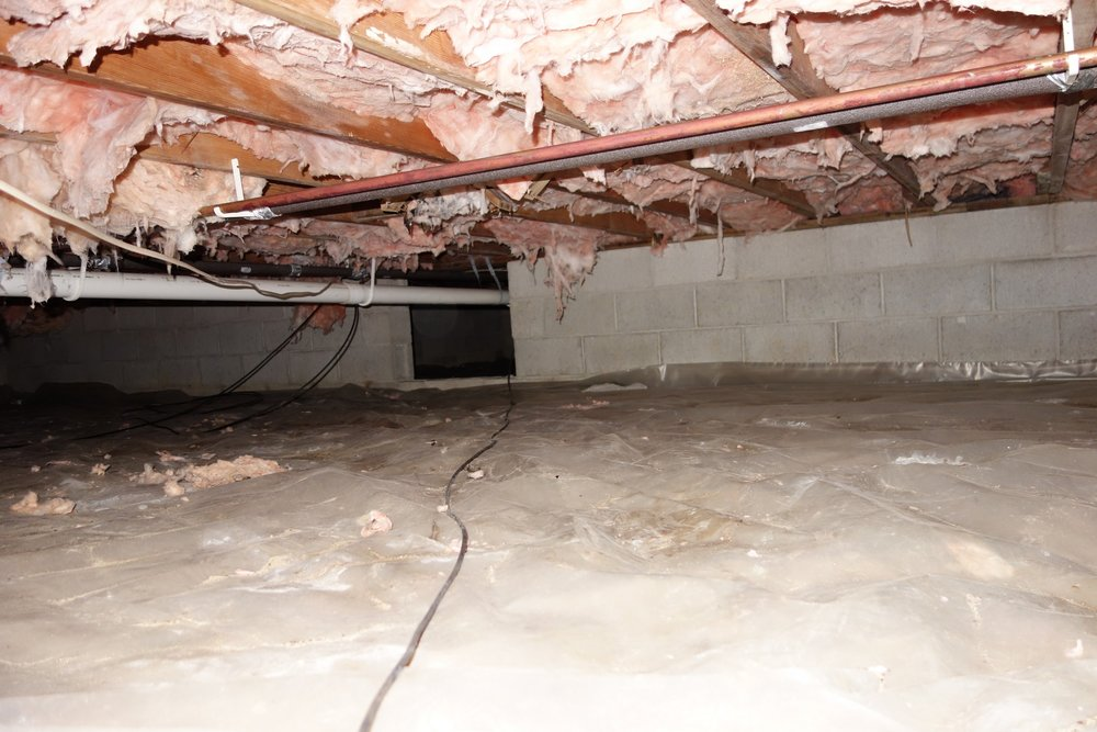 My crawl space has 3 interior walls dividing it into 4 sections. The center wall has only 1 opening, whereas the other two walls have two openings each. That single opening in the center wall really cuts down on the ability to get air circulating, so that's where I decided to placed a snail fan.