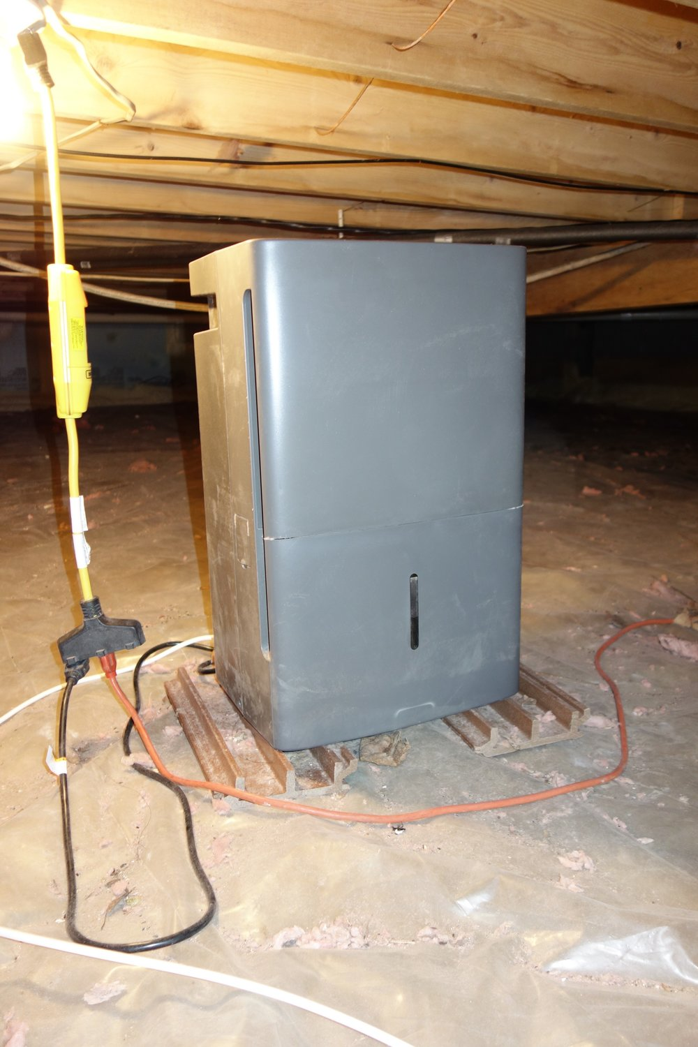 I had an existing light by the south entrance to my crawl space, the kind with 3-prong plugs on the light socket. I put them to good use for my fan and A/C unit, but I occasionally blow a fuse in the kitchen. Next year I will put in a dedicated circuit for the dehumidifier during some other planned renovation.