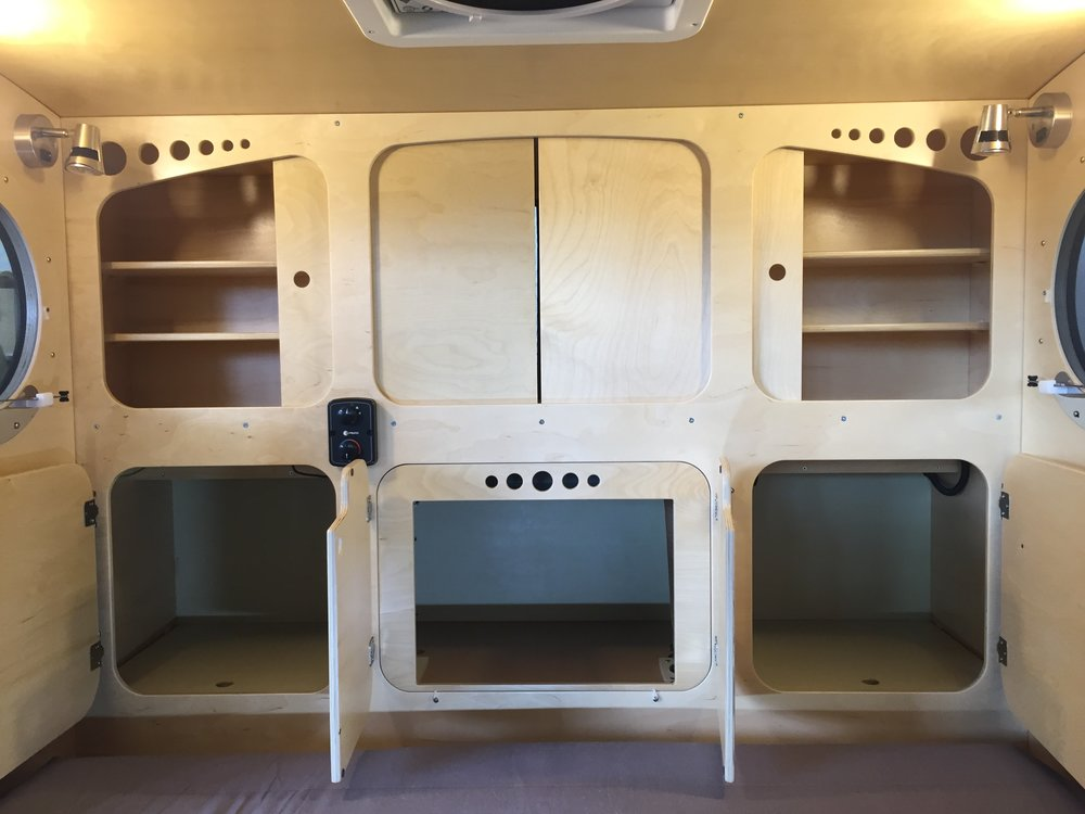 Teardrop camper _ headboard storage.jpg