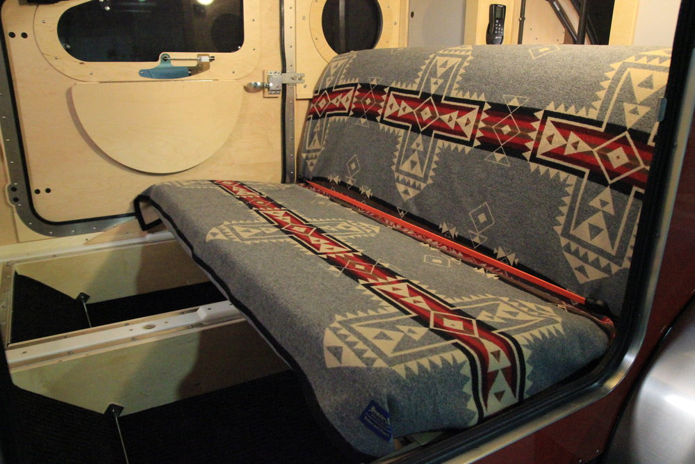 The Bed That's Also a Sofa. - Typical teardrop trailers are made so that the sleeping compartment has been almost like sleeping in a drawer–feet tucked under the galley in a dark, cave-like, and claustrophobic environment.Vistabule's design is different. Really different. You can sleep with your head at either end of the camper—no cramped feet here! But not only that, our queen-sized bed converts to a comfortable couch! Great design means with little effort, you can convert Vistabule's bedroom to a reading room, game room, observation platform, breezeway, game dining room, gazebo, and back porch all in one!
