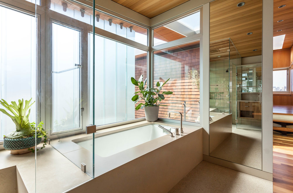 The master bath with operable frosted glass louvers for full privacy and light.