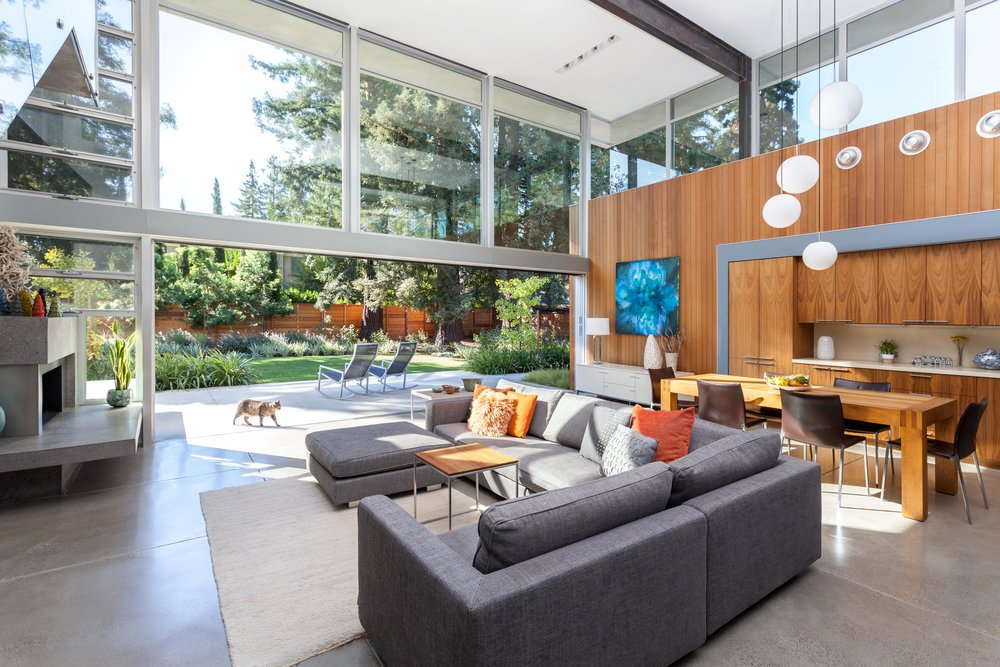 Inside Outside living with materials extending from inside to out and a 20' pocket door that disappears.  The clerestory windows provide privacy from the neighbors while providing light and air.