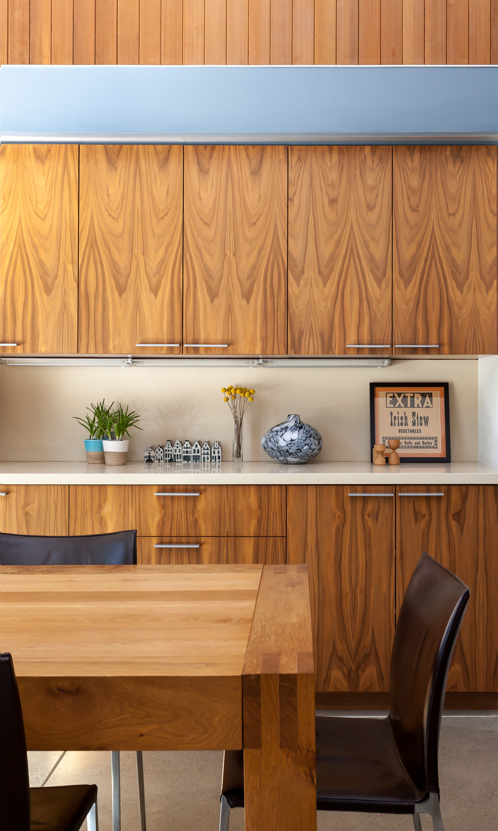 Detail of the walnut cabinetry at the dining room.