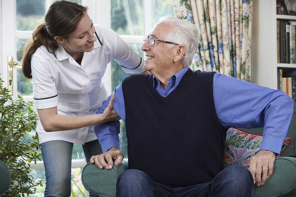 iStock_Care Worker Helping Senior Man76312633.jpg