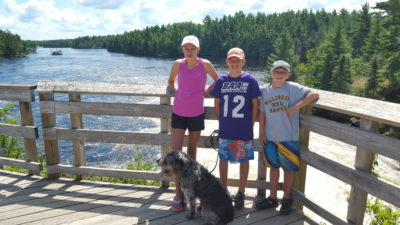 Kids standing on Kettle Falls Overlook