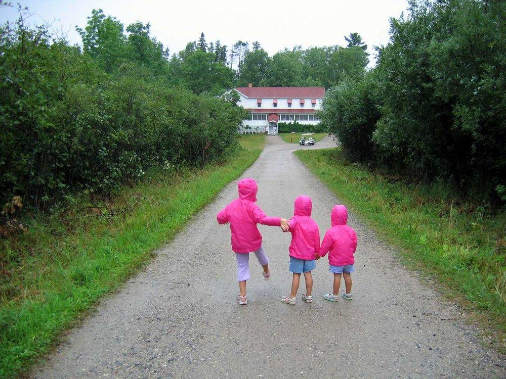 Todd Maddison   3 pink raincoats Kettle Falls.JPG
